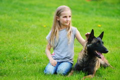Girl  with dogs. Girl playing with dogs on grass Stock Photo