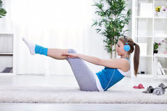 Girl doing abdominals. Young girl doing exercise for abdominals Royalty Free Stock Image
