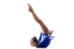 Girl doing art gymnastics. Beautiful cool teenage girl wearing dancer blue leotard working out, dancing, posing, doing art gymnastics, backbend acrobatic Stock Photos