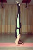 Girl doing asana headstand Stock Photo