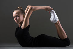 Girl doing backward extension exercise Royalty Free Stock Images
