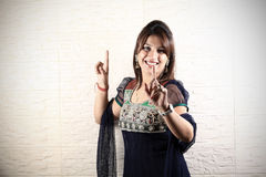 Girl doing bhangra dance stock images
