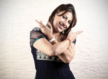 Girl doing bhangra dance Stock Images