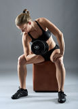 Girl doing biceps curl with dumbbells Royalty Free Stock Photos