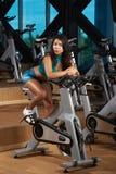 Girl doing bicycle exercises Stock Photo