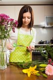 Girl  doing  bouquet on  kitchen table Stock Images