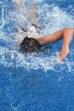Girl doing a breaststroke in pool. A young teen is doing, a breaststroke in the pool Royalty Free Stock Images
