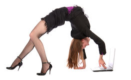 Girl doing bridge and working on notebook. Royalty Free Stock Images