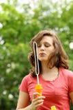 Girl doing bubble soap Stock Photos