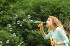 Girl doing bubble soap Royalty Free Stock Images