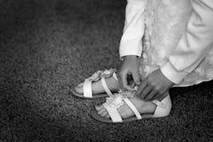 Girl Doing Buckel on White Sandal Stock Photos