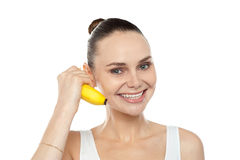 Girl doing call gesture using banana as cellphone Stock Photos