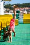 Girl doing cartwheels on Croatian ferryboat in Mali Losinj stock image