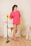 Girl doing cleaning Stock Images