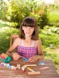 Girl doing craft Stock Image