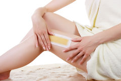 Girl doing depilation with wax on the feet. Royalty Free Stock Photo