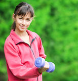 Girl doing dumbbell exercise outdoor Royalty Free Stock Photo