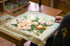 Girl doing embroidery vase with flowers Royalty Free Stock Photo