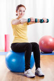 Girl doing excercise at the gym Stock Photo