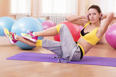 Girl doing exercise on belly Royalty Free Stock Images