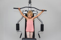 Girl doing exercise in the gym Royalty Free Stock Image