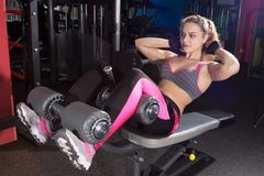Girl doing exercise on the press. Stock Photography