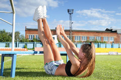 Girl doing exercises for abdominal Stock Images