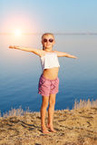 Girl doing exercises on the beach Stock Photography