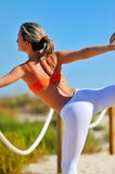 Girl doing exercises on the beach Royalty Free Stock Images