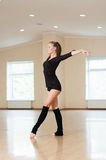 Girl doing exercises in a dance class Royalty Free Stock Image