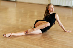 Girl doing exercises in a dance class Stock Images