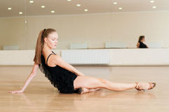 Girl doing exercises in a dance class Stock Photos