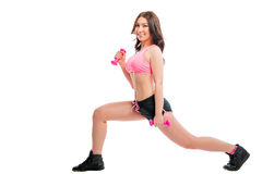 Girl doing exercises with dumbbells Stock Photo