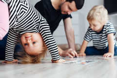 Girl doing exercises on the floor Stock Images