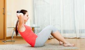 Girl  doing exercises on floor Stock Image
