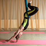 Girl doing exercises fly-Yoga royalty free stock images