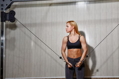 Girl doing exercises in the gym Stock Photography