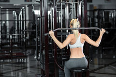 Girl doing exercises on her back in the gym Stock Images
