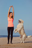 Girl doing exercises with her dog Stock Images