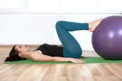 Girl doing exercises lying on the floor. stock images