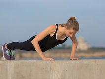 Girl doing exercises on open air Royalty Free Stock Photography