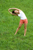 Girl doing exercises in park Stock Photo