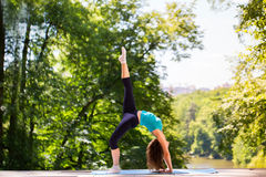 Girl doing exercises in the park. Stock Image
