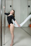 Girl doing exercises on the pylon. royalty free stock photography
