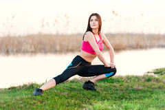 Girl doing exercises on the River Royalty Free Stock Photos