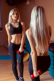 Girl is doing exercises Stock Image