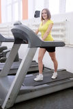 Girl doing exercises on a treadmill royalty free stock image