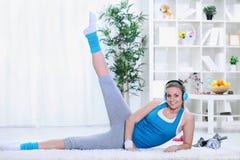 Girl doing exercising for legs. Teenagers girl doing exercising for legs in living room Stock Photo