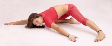 Girl doing fitness excersises. Attractive brunette girl doing fitness excersises Royalty Free Stock Photo