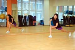 Girl doing fitness in the sport center Stock Photo